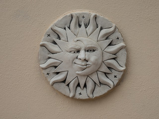 symbol sun and moon made of ceramics on a wall
