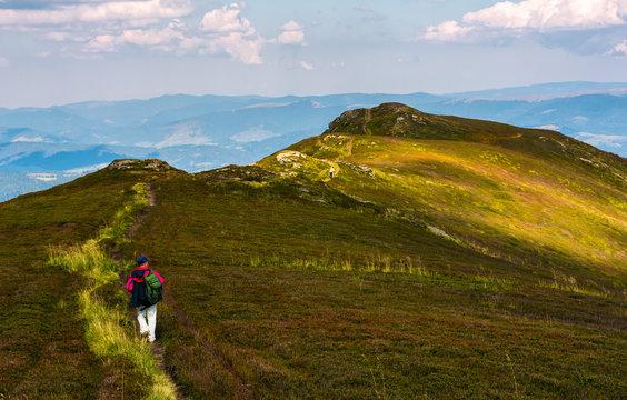 tourist on a foot path of mountain ridge. beautiful travel scenery