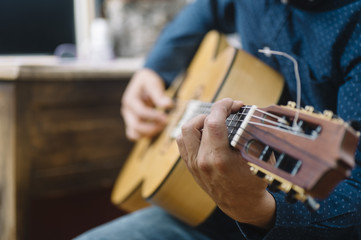 man who studied music with guitar