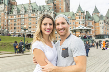 Couple in front of Chateau Frontenac at Quebec city Canada