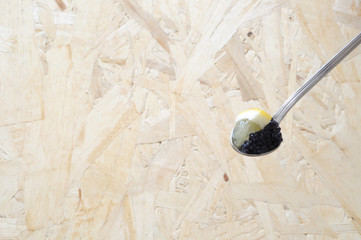 spoon with black lumpfish eggs