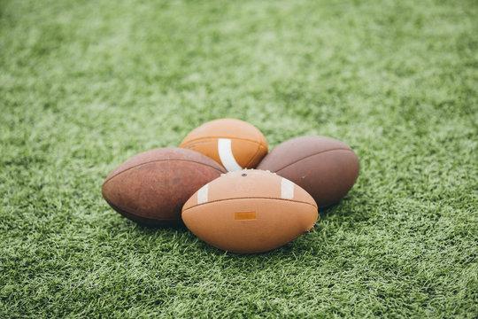 American footballs on field