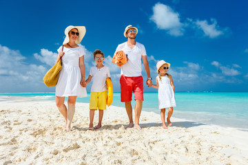Wall Mural - Family on a tropical beach vacation