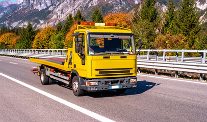 Car tow truck in a hurry to help. Austria.