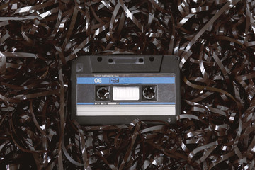 Old audio cassette on a bed of loose tape