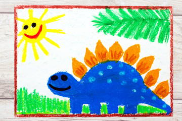 Photo of colorful drawing: Smiling dinosaur. Big blue stegosaurus.