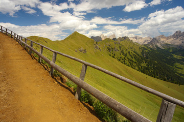Mountain way with a woody balustrade, Dolomites, Italy