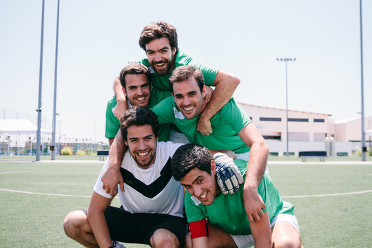 Portrait of soccer players having fun during a sunny day