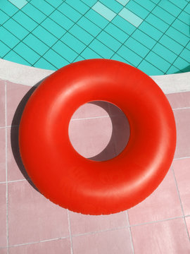 red inflatable belt at the swimming pool