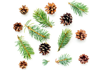New year symbols pattern. Spruce branches and cones on white background top view