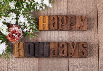 Happy Holidays Text on a Wooden Background