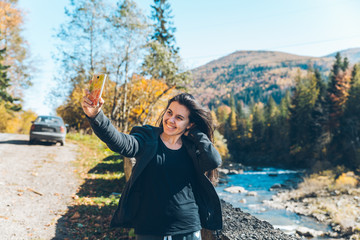 woman taking picture of carpathian mointains