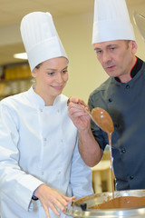 female assistant and pastry chef making caramel topping