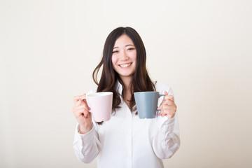 young asian woman giving mug cup