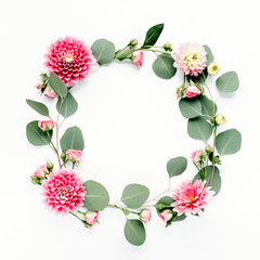 Floral round frame wreath made of pink and beige peonies flower buds, branches and leaves isolated on white background. Flat lay, top view. Frame of flowers. Floral background. Valentine's