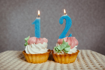 Happy 12 birthday - burning blue number candles on cupcakes