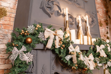 Christmas tree branch on fireplace and other holiday decorations in dark loft