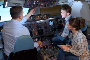 People in aircraft simulator