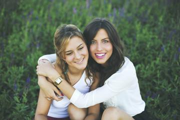 Two happy female friends