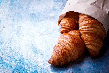 Breakfast Continental  with Fresh  Croissants in the Paper Package.Delicious Baking   Street Food. Top View Copy space for Text