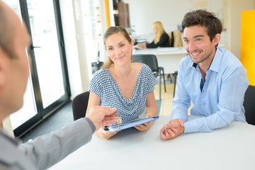 young couple meeting with realtor