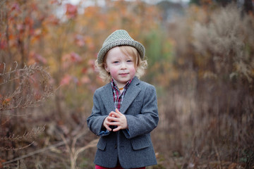 Portrait of a young boy wearing a fedora hat and blazer