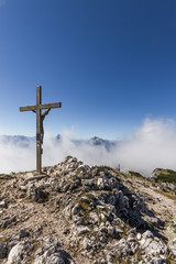 summit cross in alpine landscape