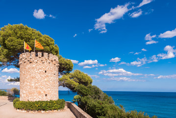 Observation tower on the rock in Miami Platja, Tarragona, Catalunya, Spain. Copy space for text.