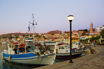 Early morning at the harbour of Greek island Chalki with fishing boats