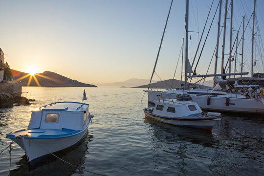 Sunrise as seen from the port of Greek island Chalki