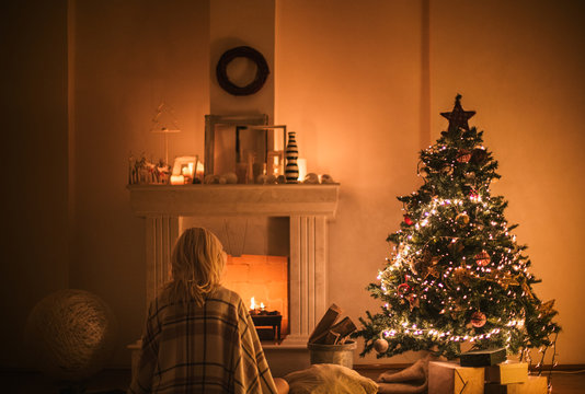 Woman by the Fireplace on Christmas Eve