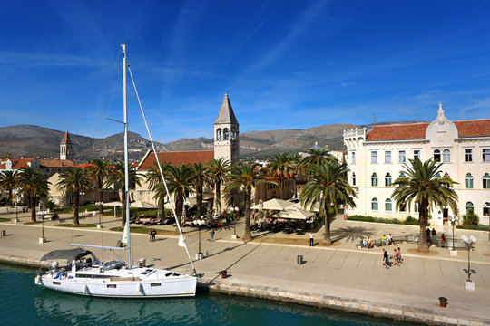 Trogir port with sail boat docked in front of St. Dominic church, Croatia