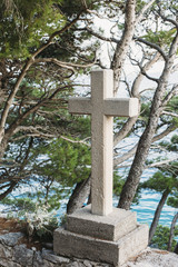 A cross, a Catholic relagious symbol by the sea