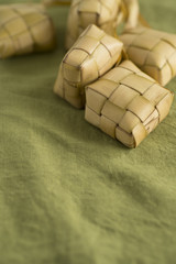 Ketupat or rice dumpling packed inside woven palm leaf pouch