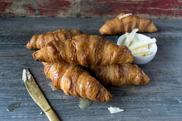 french butter croissants on gray background top view closeup
