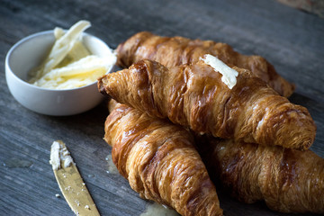 french butter croissants on gray background