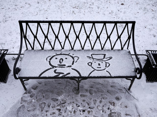 Two characters drawn on a snowy bench