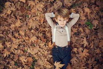 Child in autumn leafs