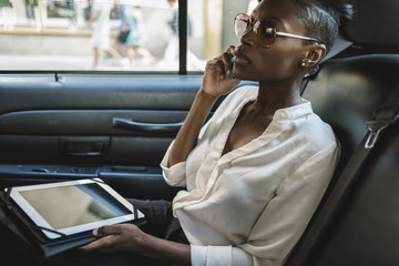 Businesswoman working sitting in the cab