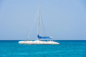 Sailing yacht on the shore of the island Saona, Dominican Republic. Copy space for text.
