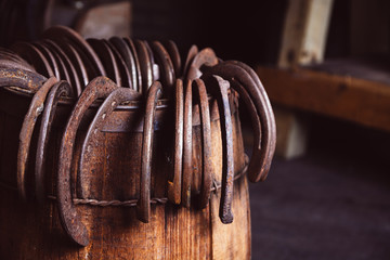 Horseshoes on display in an old blacksmith shop