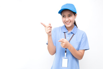 Portrait of happy delivery asian woman with her hand point up isolated on white background, young asian woman wearing blue uniform delivery service concept