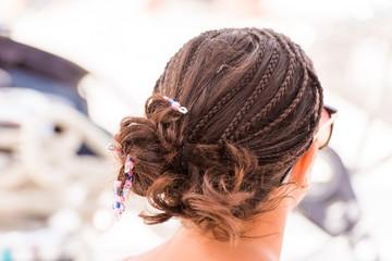 Hairstyle from pigtails, Saona island, Dominican Republic. Close-up.