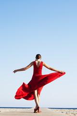 Flamenco dancer walking by the Mediterranean Sea, Barcelona. Spain