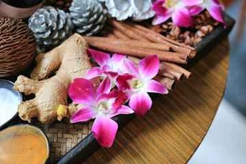 Thai style skin scrub and massage consisted of nature ingredient. Orchid flower on wooden tray, Health care and spa concept. Nature spa ingredient.