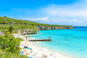 Porto Marie beach - white sand Beach with blue sky and crystal clear blue water in Curacao, Netherlands Antilles, a Caribbean Island Wall mural