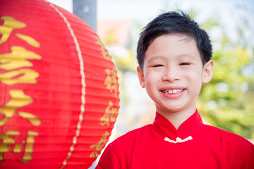 Young chinese boy wearing traditional dress smiling outdoor