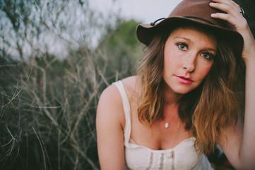 Portrait of pretty stylish woman wearing hat