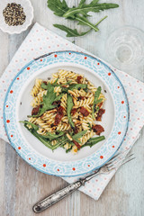 Food: Summer Salad with Noodles, dried tomato, rocket, roasted pine nuts and balsamico