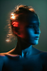 Blurred woman surrounded by dark lights
